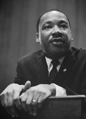 Martin-Luther-King-1964-leaning-on-a-lectern